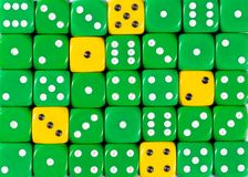 Background of random ordered green dices with five yellow cubes. Pattern background of random ordered green dices with five yellow cubes stock photo