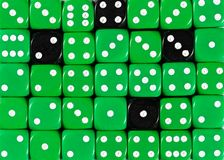 Background of random ordered green dices with four black cubes. Pattern background of random ordered green dices with four black cubes stock photos