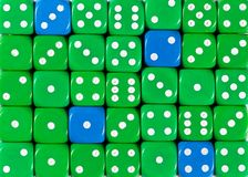 Background of random ordered green dices with four blue cubes. Pattern background of random ordered green dices with four blue cubes royalty free stock photo
