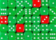 Background of random ordered green dices with four red cubes. Pattern background of random ordered green dices with four red cubes royalty free stock photos