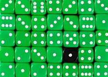 Background of random ordered green dices with one black cube. Pattern background of random ordered green dices with one black cube stock image