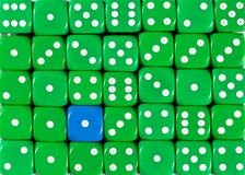 Background of random ordered green dices with one blue cube. Pattern background of random ordered green dices with one blue cube royalty free stock photos