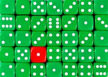 Background of random ordered green dices with one red cube. Pattern background of random ordered green dices with one red cube royalty free stock images