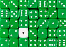 Background of random ordered green dices with one white cube. Pattern background of random ordered green dices with one white cube stock photo