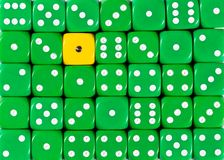 Background of random ordered green dices with one yellow cube. Pattern background of random ordered green dices with one yellow cube royalty free stock images