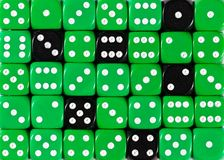 Background of random ordered green dices with six black cubes. Pattern background of random ordered green dices with six black cubes royalty free stock image