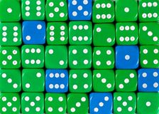 Background of random ordered green dices with six blue cubes. Pattern background of random ordered green dices with six blue cubes stock photos
