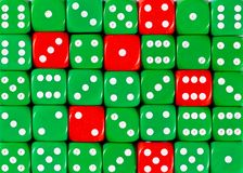 Background of random ordered green dices with six red cubes. Pattern background of random ordered green dices with six red cubes stock photography