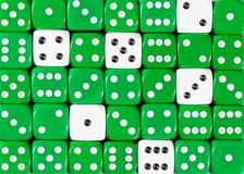 Background of random ordered green dices with six white cubes. Pattern background of random ordered green dices with six white cubes royalty free stock photos