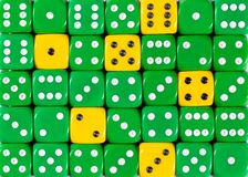Background of random ordered green dices with six yellow cubes. Pattern background of random ordered green dices with six yellow cubes stock photography