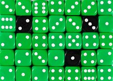 Background of random ordered green dices with three black cubes. Pattern background of random ordered green dices with three black cubes royalty free stock photos