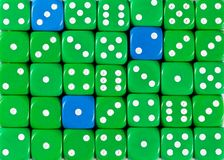 Background of random ordered green dices with three blue cubes. Pattern background of random ordered green dices with three blue cubes royalty free stock images