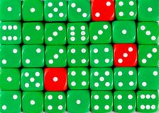Background of random ordered green dices with three red cubes. Pattern background of random ordered green dices with three red cubes royalty free stock photography