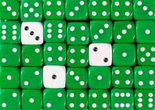 Background of random ordered green dices with three white cubes. Pattern background of random ordered green dices with three white cubes stock photography