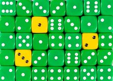 Background of random ordered green dices with three yellow cubes. Pattern background of random ordered green dices with three yellow cubes royalty free stock photography