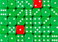 Background of random ordered green dices with two red cubes. Pattern background of random ordered green dices with two red cubes stock photo