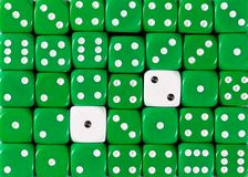 Background of random ordered green dices with two white cubes. Pattern background of random ordered green dices with two white cubes royalty free stock photo
