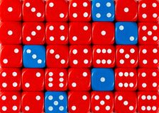Background of random ordered red dices with five blue cubes. Pattern background of random ordered red dices with five blue cubes royalty free stock photos