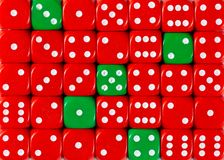 Background of random ordered red dices with five green cubes. Pattern background of random ordered red dices with five green cubes royalty free stock images