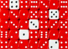 Background of random ordered red dices with five white cubes. Pattern background of random ordered red dices with five white cubes royalty free stock image