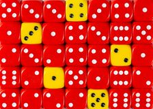 Background of random ordered red dices with five yellow cubes. Pattern background of random ordered red dices with five yellow cubes stock image
