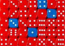 Background of random ordered red dices with four blue cubes. Pattern background of random ordered red dices with four blue cubes royalty free stock images