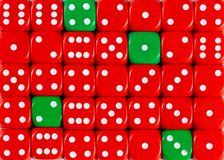 Background of random ordered red dices with four green cubes. Pattern background of random ordered red dices with four green cubes royalty free stock photos