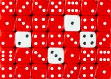 Background of random ordered red dices with four white cubes. Pattern background of random ordered red dices with four white cubes stock images