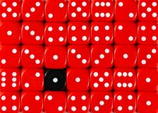 Background of random ordered red dices with one black cube. Pattern background of random ordered red dices with one black cube stock image