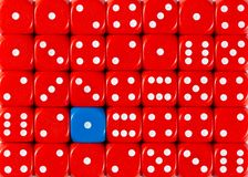 Background of random ordered red dices with one blue cube. Pattern background of random ordered red dices with one blue cube royalty free stock photo