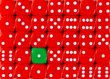 Background of random ordered red dices with one green cube. Pattern background of random ordered red dices with one green cube royalty free stock photography