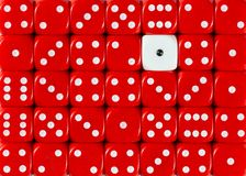 Background of random ordered red dices with one white cube. Pattern background of random ordered red dices with one white cube royalty free stock photography