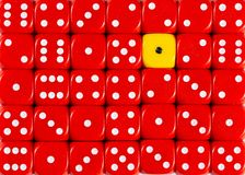 Background of random ordered red dices with one yellow cube. Pattern background of random ordered red dices with one yellow cube royalty free stock photo