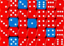 Background of random ordered red dices with six blue cubes. Pattern background of random ordered red dices with six blue cubes stock image