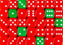 Background of random ordered red dices with six green cubes. Pattern background of random ordered red dices with six green cubes royalty free stock image