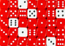 Background of random ordered red dices with six white cubes. Pattern background of random ordered red dices with six white cubes royalty free stock photo