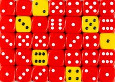 Background of random ordered red dices with six yellow cubes. Pattern background of random ordered red dices with six yellow cubes royalty free stock image