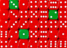 Background of random ordered red dices with three green cubes. Pattern background of random ordered red dices with three green cubes stock photography