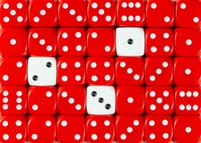 Background of random ordered red dices with three white cubes. Pattern background of random ordered red dices with three white cubes royalty free stock photos