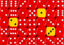 Background of random ordered red dices with three yellow cubes. Pattern background of random ordered red dices with three yellow cubes stock photos