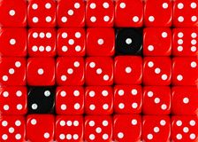 Background of random ordered red dices with two black cubes. Pattern background of random ordered red dices with two black cubes royalty free stock images