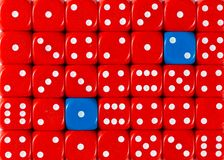 Background of random ordered red dices with two blue cubes. Pattern background of random ordered red dices with two blue cubes royalty free stock photography