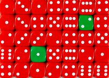 Background of random ordered red dices with two green cubes. Pattern background of random ordered red dices with two green cubes stock image