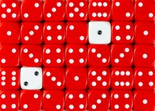 Background of random ordered red dices with two white cubes. Pattern background of random ordered red dices with two white cubes royalty free stock photos