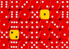 Background of random ordered red dices with two yellow cubes. Pattern background of random ordered red dices with two yellow cubes royalty free stock photography