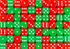 Background of 70 random ordered red and green dices. YellowPattern background of 70 random ordered red and green dices royalty free stock image