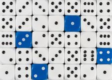 Background of random ordered white dices with four blue cubes royalty free stock photos