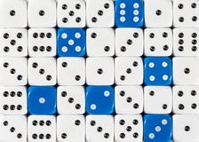 Background of random ordered white dices with six blue cubes. Pattern background of random ordered white dices with six blue cubes royalty free stock images