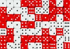 Background of 70 random ordered white and red dices. Pattern background of 70 random ordered white and red dices royalty free stock images