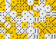 Background of 70 random ordered white and yellow dices. Pattern background of 70 random ordered white and yellow dices stock photo